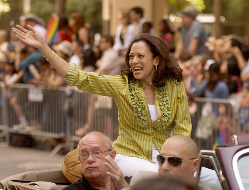 San Francisco District Attorney Kamala Harris, top, waves to the crowd during the annual Gay Pride Parade along Market Street on Sunday, June 28, 2009 in San Francisco, California.