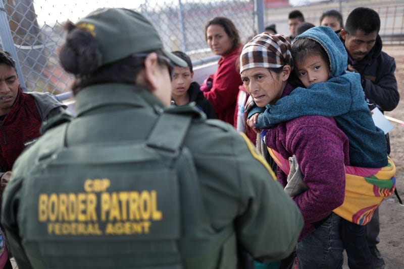 A U.S. Border Patrol agent takes Central American immigrants into custody after they crossed the U.S. Mexico border on February 01, 2019 in El Paso, Texas. The migrants, who said they were from Guatemala, turned themselves in to U.S. Border Patrol agents, seeking political asylum in the United States.