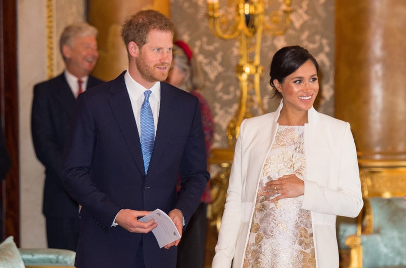 meghan markle and prince harry and prince charles's 50th anniversary investiture reception at buckingham palace
