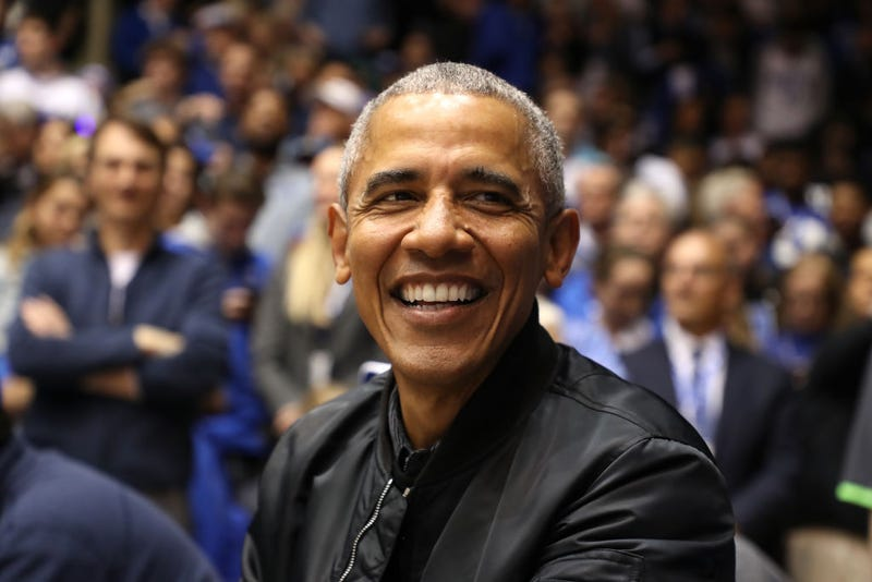 Former President of the United States, Barack Obama, watches on during the game between the North Carolina Tar Heels and Duke Blue Devils at Cameron Indoor Stadium