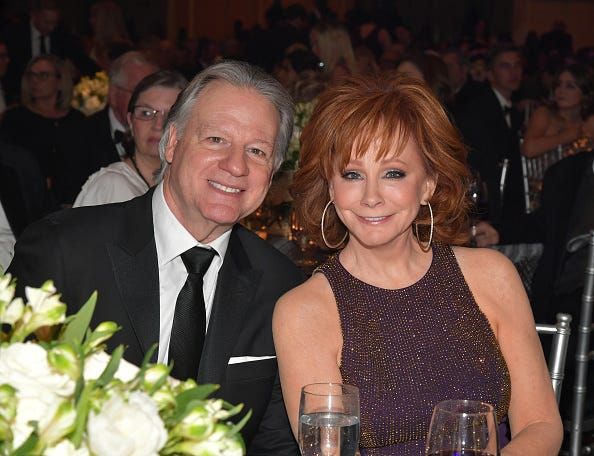 Skeeter Lasuzzo and host Reba McEntire attend Celebrity Fight Night