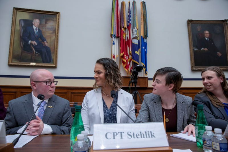 """Navy Lt. Commander Blake Dremann, Army Capt. Alivia Stehlik, Army Capt. Jennifer Peace and Army Staff Sgt. Patricia King at the Military Personnel Subcommittee hearing on """"Transgender Service Policy."""" on Capital Hill on February 27, 2019 in Washington, DC. (Photo by Tasos Katopodis/Getty Images)"""