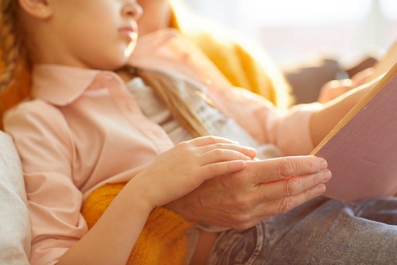 Grandma reading story to granddaughter