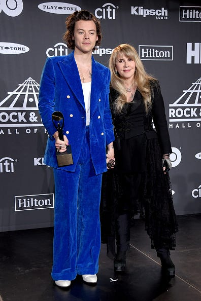 harry styles in blue at Stevie Nicks Rock and Roll Hall of Fame Induction Ceremony