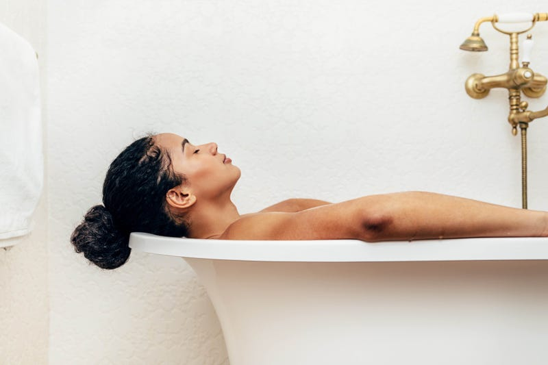 A woman relaxes in the bath