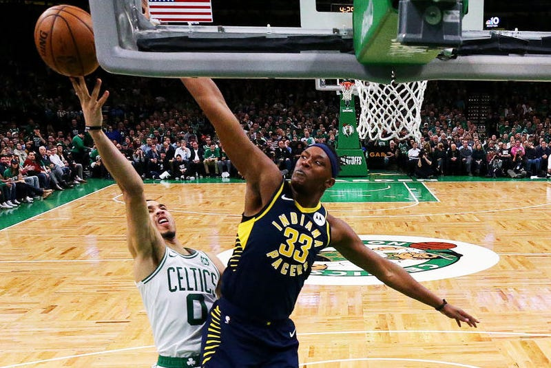 Myles Turner defends a layup attempt from Jayson Tatum.