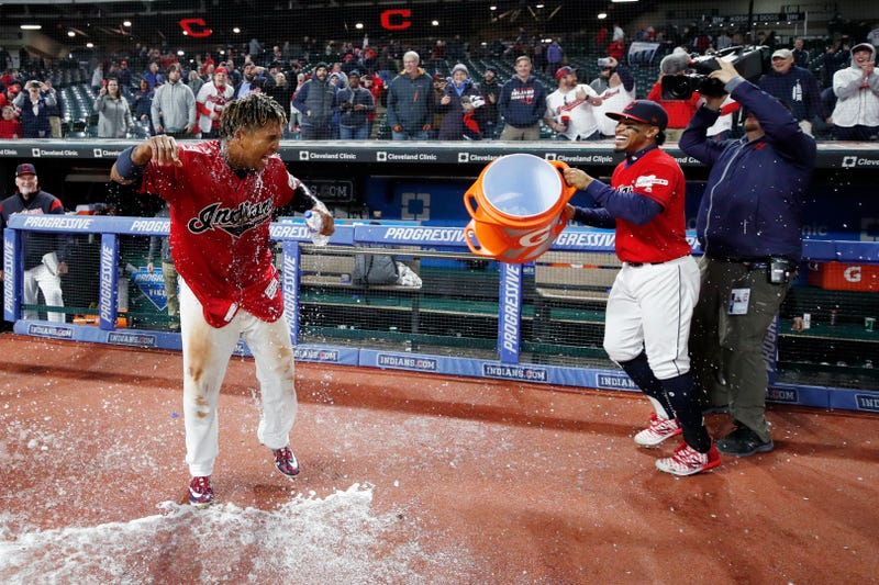 Francisco Lindor dumps a bucket of Gatorade on teammate Jose Ramirez after a walk-off hit