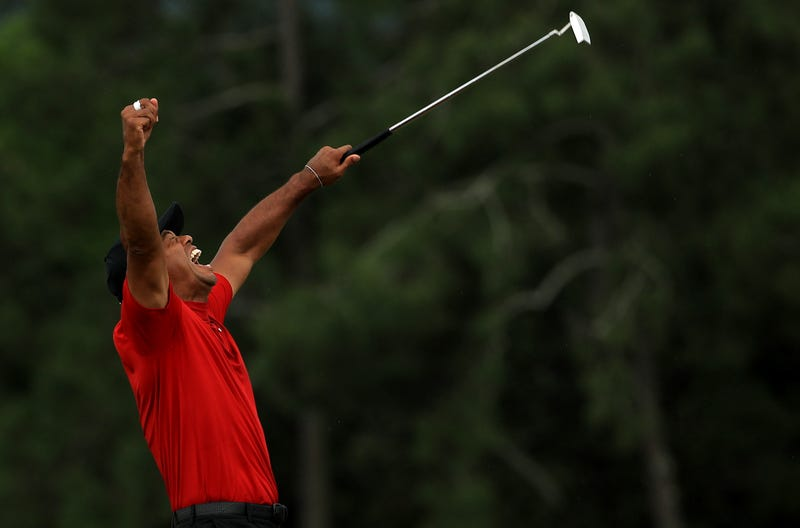 Tiger Woods celebrates after sinking the winning putt at the 2019 Masters