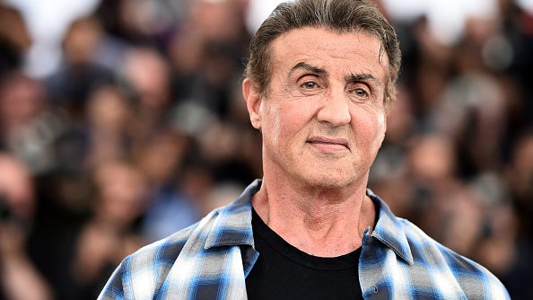Sylvester Stallone, 74, shows off massive bicep in workout photo: 'Doing some old school action'