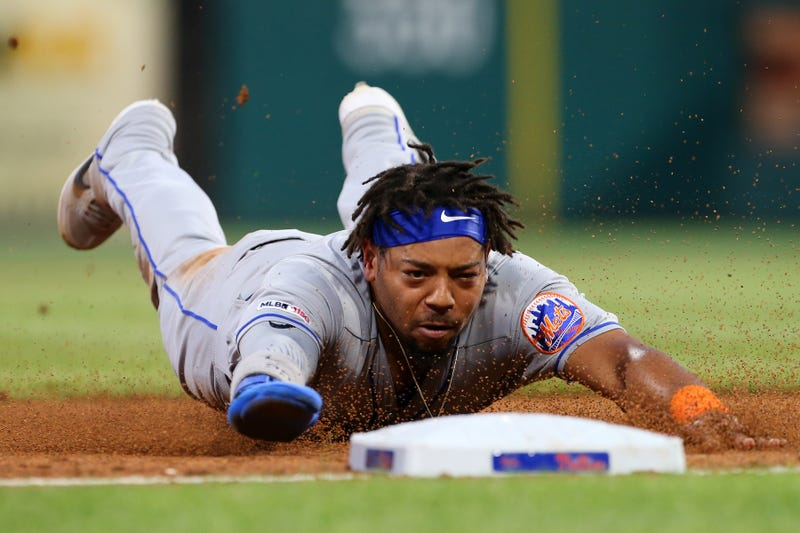 Dominic Smith diving safely into third base
