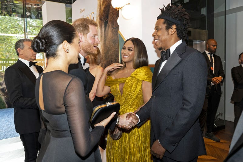"Prince Harry, Duke of Sussex (3rd L) and Meghan, Duchess of Sussex (2nd L) meet cast and crew, including Beyonce Knowles-Carter (C) Jay-Z (R) as they attend the European Premiere of Disney's ""The Lion King"" at Odeon Luxe Leicester Square on July 14, 2019 in London, England."