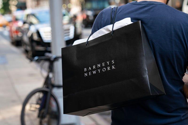 shopper in new york carrying barney's bag