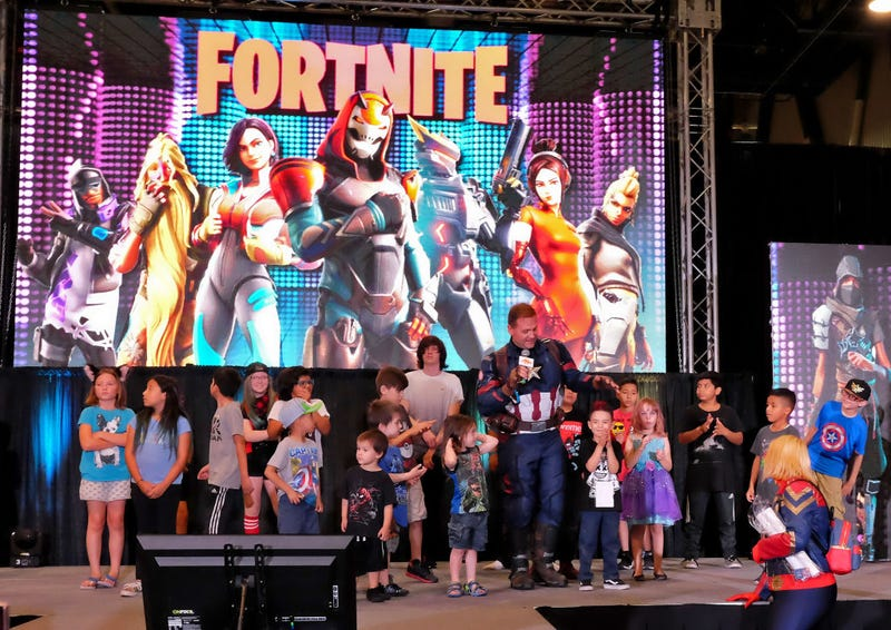 Attendees compete in a 'Fortnite' dance competition during the Seventh Annual Amazing Las Vegas Comic Con at the Las Vegas Convention Center.