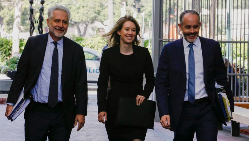 Former Theranos CEO Elizabeth Holmes (C) and lawyer Kevin Downey (L) appear in federal court for a status hearing on July 17, 2019 in San Jose, California.