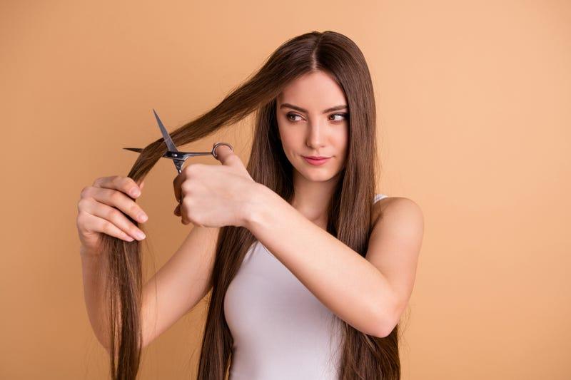 woman cutting own hair