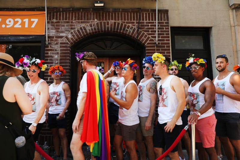People gather in front of the Stonewall Inn in celebration of Pride in NYC on June 28, 2019
