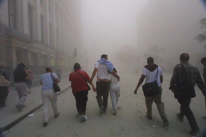 394261 50: Civilians flee as a tower of the World Trade Center collapses September 11, 2001 after two airplanes slammed into the twin towers in an alleged terrorist attack.