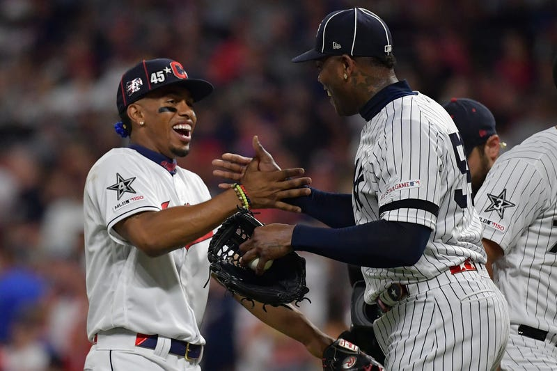 Francisco Lindor and New York Yankees closer Aroldis Chapman embrace at the 2019 MLB All-Star Game.