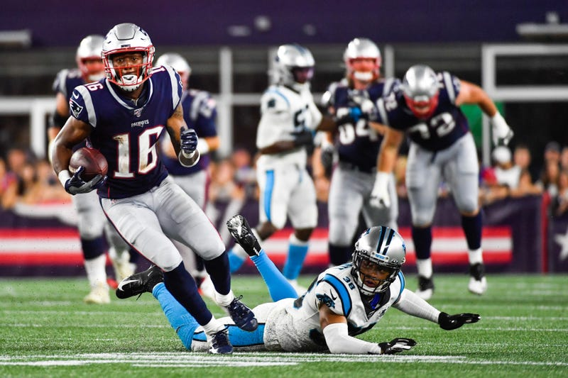 Jakobi Meyers #16 of the New England Patriots runs past Javien Elliot #38 of the Carolina Panthers in the second quarter of a preseason game at Gillette Stadium on August 22, 2019 in Foxborough, Massachusetts