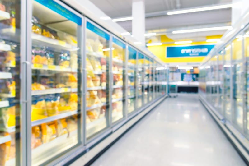 Frozen food freezers and shelves in the supermarket.
