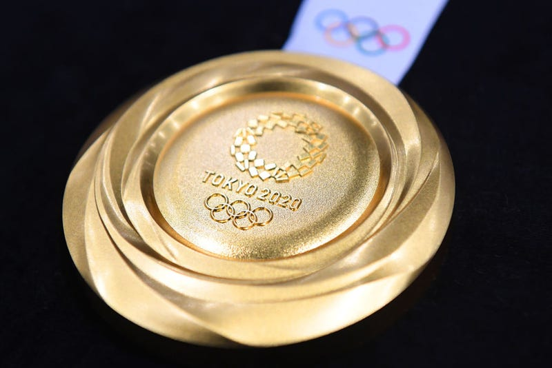 The gold medal is displayed after the Tokyo 2020 medal design unveiling ceremony