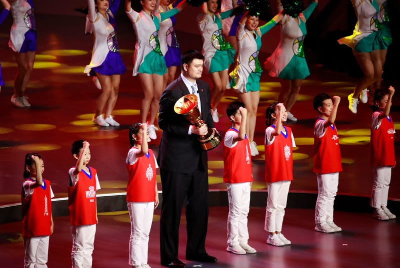Former Chinese NBA player Yao Ming holds the FIBA World Cup trophy during the FIBA Basketball World Cup 2019 opening ceremony at the Beijing National Aquatics Center or Water Cube on 30 August 2019