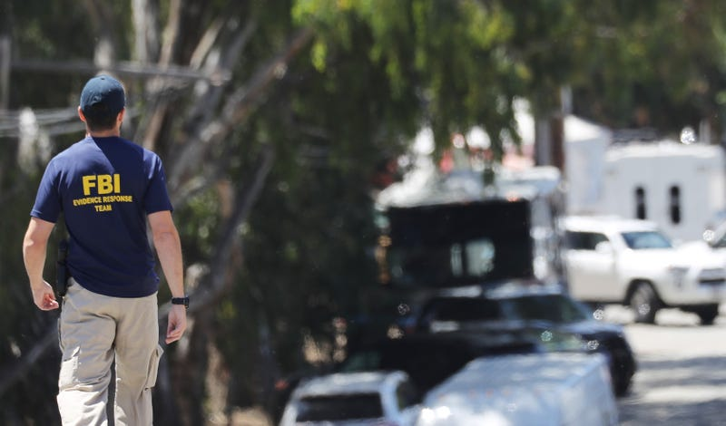 An FBI agent walks toward the site of the Gilroy Garlic Festival after a mass shooting took place there yesterday on July 29, 2019 in Gilroy, California.