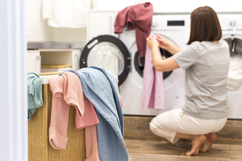 A woman doing laundry