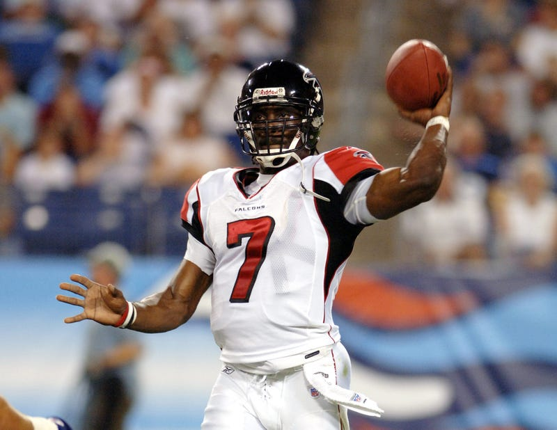 michael vick throws for atlanta falcons