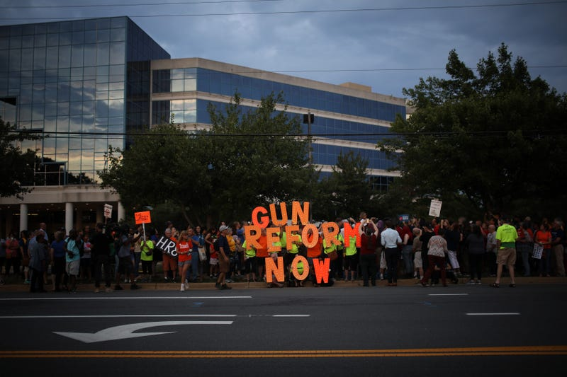 A candle light vigil for gun victims outside the NRA's headquarters.