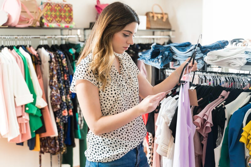 woman checking price tag on clothing