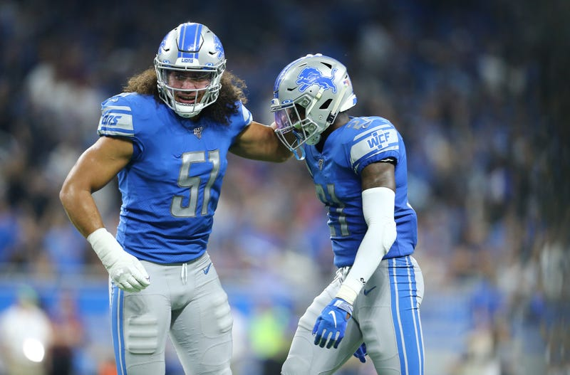 Jahlani Tavai (left) and Darius Slay (right) helped the Lions to upset the Chargers.