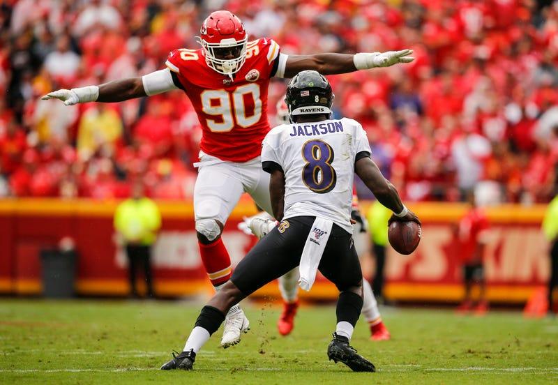 Emmanuel Ogbah lunges at Ravens quarterback Lamar Jackson