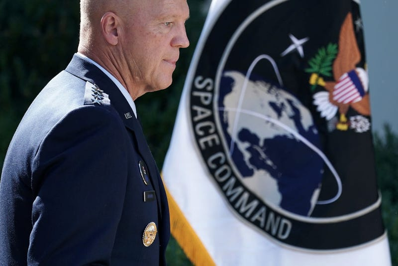 """U.S. Air Force Space Command Gen. John """"Jay"""" Raymond stands next to the flag of the newly established U.S. Space Command, the sixth national armed service, in the Rose Garden at the White House August 29, 2019 in Washington, DC."""