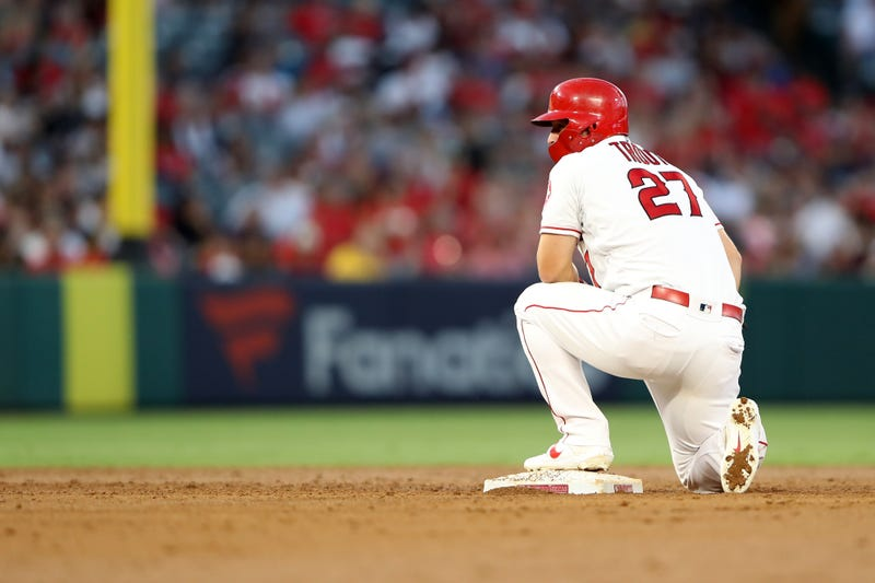 Halos outfielder Mike Trout takes a knee at second base