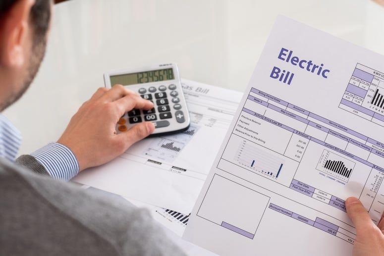 Man paying electric bill
