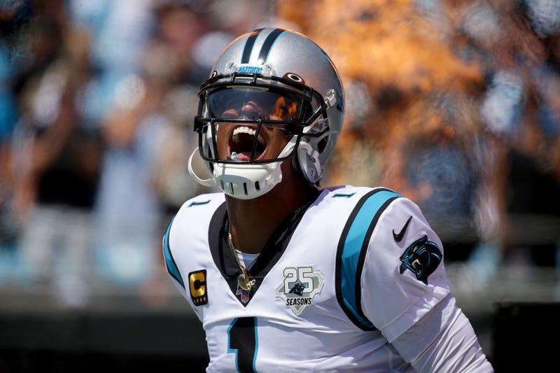 Quarterback Cam Newton takes the field for Carolina
