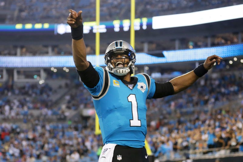 Cam Newton leads the Panthers downfield