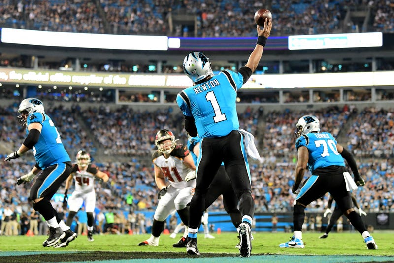 Cam Newton gets off a pass against Tampa Bay