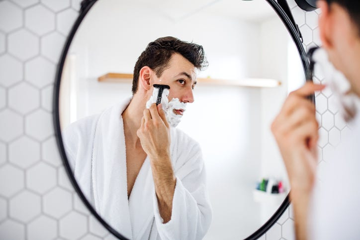 man shaving and grooming