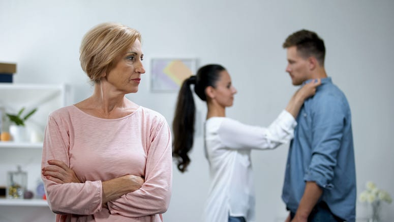 Mother-in-law glaring at couple