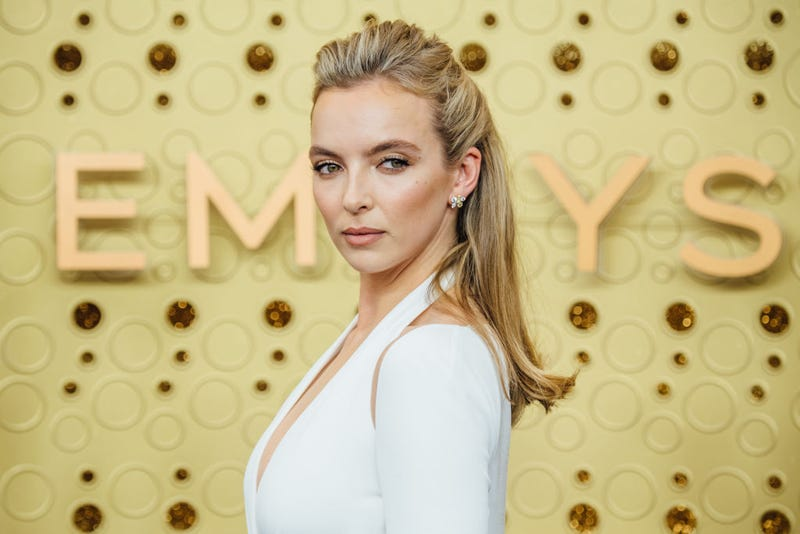 jodie comer poses on the red carpet at the 2019 emmy awards