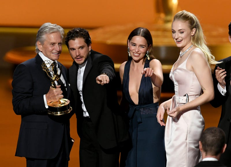 michael douglas presents outstanding drama series for game of thrones to kit harrington, emilia clarke and sophie turner