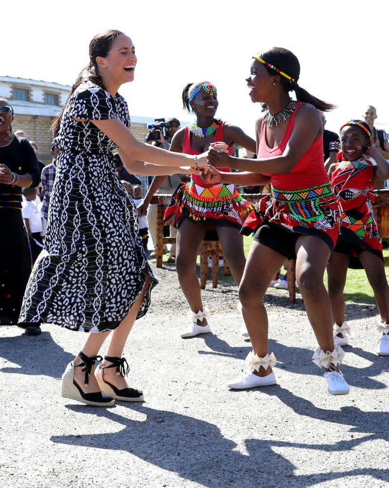 Meghan Markle is all smiles as she dances in South Africa.