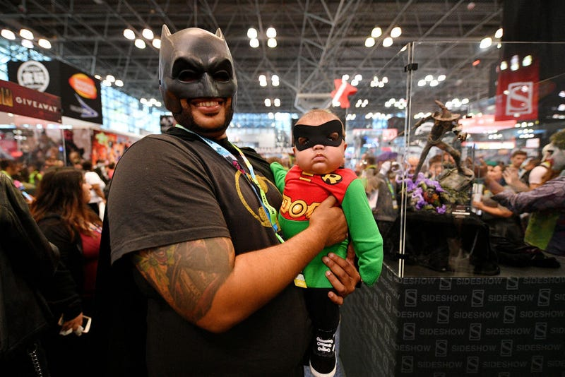 osplayers dressed as Batman and Robin attend New York Comic Con 2019 Day 3 at Jacob K. Javits Convention Center.