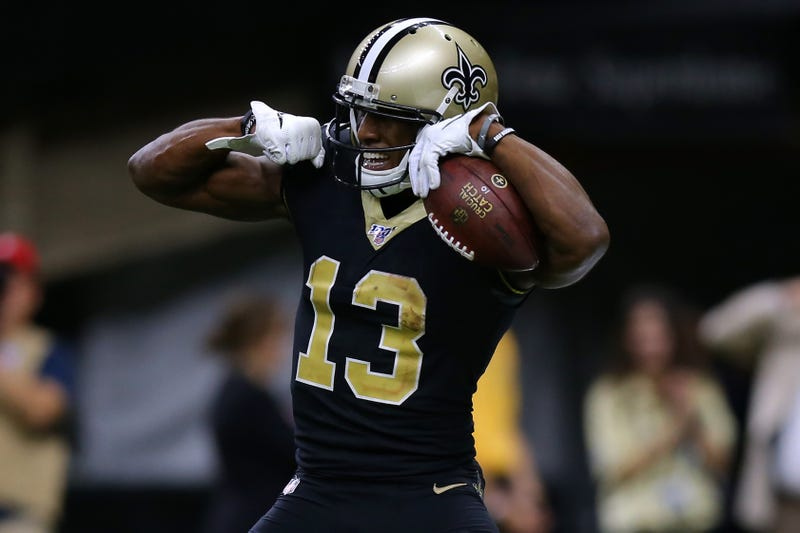 Saints receiver Michael Thomas flexes after scoring a touchdown