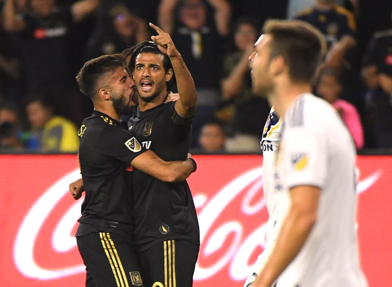 Carlos Vela #10 of Los Angeles FC celebrates his goal with Diego Rossi #9, to take a 1-0 lead over the Los Angeles Galaxy, during the first half of the Western Conference Semifinals at Banc of California Stadium on October 24, 2019 in Los Angeles, California.