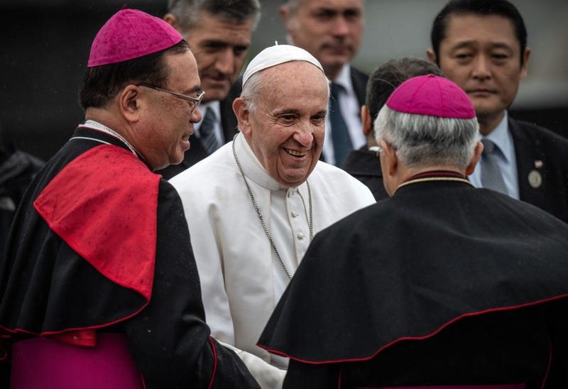 Pope Francis is bade farewell by senior Catholic clergy as he prepares to board his plane before leaving Japan