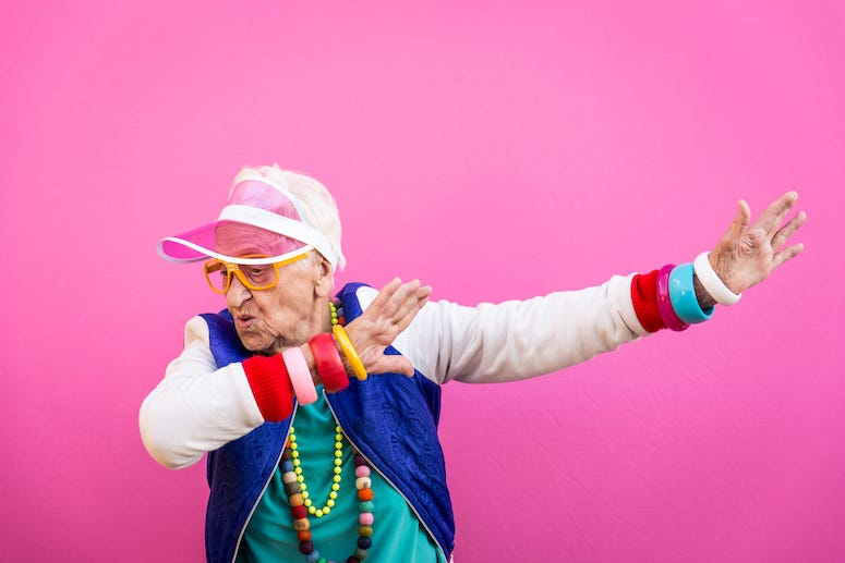 Grandmother wearing '80s outfit dabbing