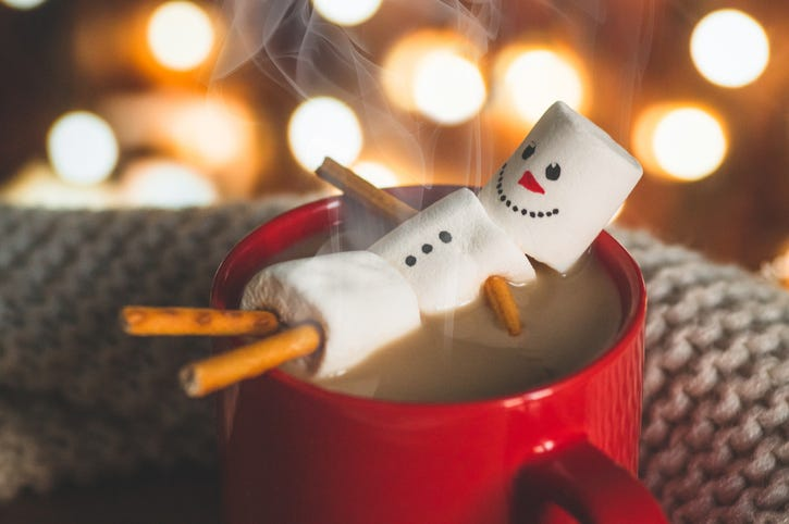 a snowman in hot cocoa